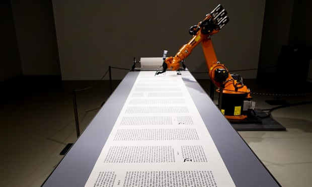 An industrial robot writes out the Bible by Amy Cicconi